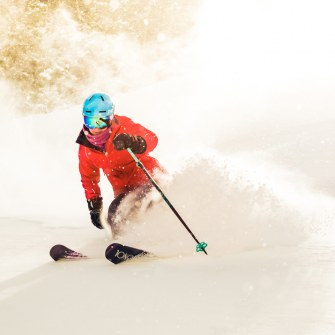 Woman skiing at downhill ski area in New Mexico