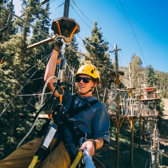 Red River employee working on ropes course