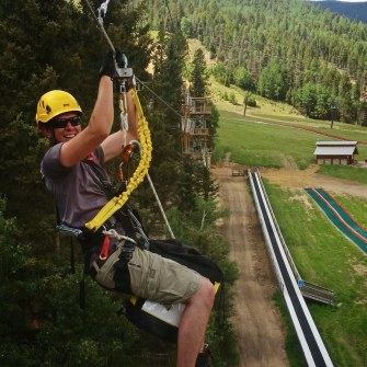 Red River employee working on aerial ropes course