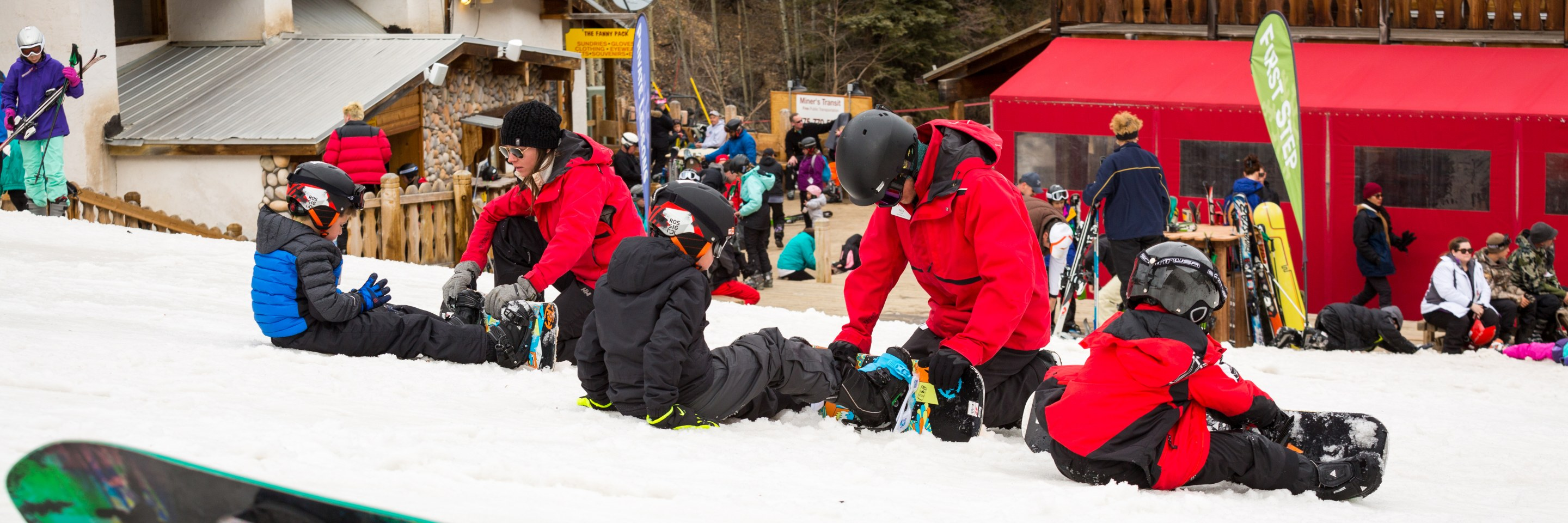snowboard coaches teaching a lesson
