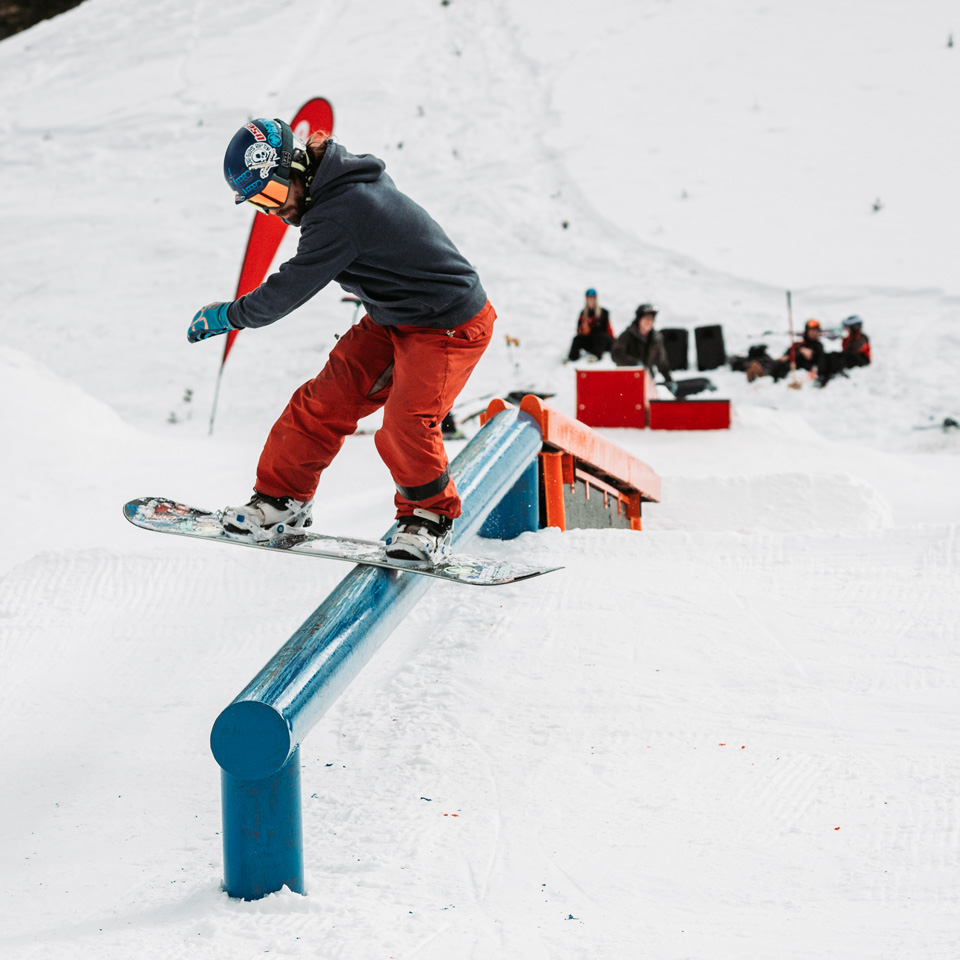 snowboarder hitting a rail in the terrain park